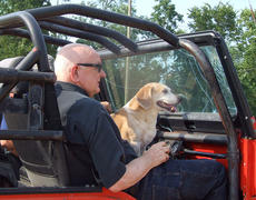 """<div class=""""source"""">Stephen Lega</div><div class=""""image-desc"""">Dr. James Bland, owner of Popes Creek Ranch, rode on the Jeep that pulled the tomato cart. </div><div class=""""buy-pic""""><a href=""""http://web2.lcni5.com/cgi-bin/c2newbuyphoto.cgi?pub=015&orig=07-30-14_tomato_conflict_pic_5.jpg"""" target=""""_new"""">Buy this photo</a></div>"""
