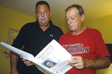 """<div class=""""source"""">Stevie Lowery</div><div class=""""image-desc"""">Tim Miller (in red shirt), founding director of Texas EquuSearch, and Jamie Copenhaver, one of Miller's volunteers who has worked in various levels of law enforcement during his career, are pictured looking over Kara Tingle Rigdon's missing person's case file during their visit in Marion County this week.</div><div class=""""buy-pic""""></div>"""