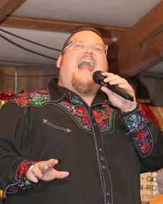 "<div class=""source"">Nicolas Schrager</div><div class=""image-desc"">Clinton Spaulding of Louisville gave a performance that left the crowd hungry for more. Here he gives his first performance of the evening. Spaulding sang to music played by the 68 Drifters.</div><div class=""buy-pic""><a href=""/photo_select/36227"">Buy this photo</a></div>"