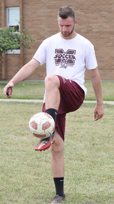 """<div class=""""source"""">Nick Schrager</div><div class=""""image-desc"""">Lady Knights Coach Derek Cissell demonstrates some foot work to a student. </div><div class=""""buy-pic""""><a href=""""/photo_select/36412"""">Buy this photo</a></div>"""