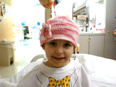 """<div class=""""source"""">Photo provided by Diane Erjavec</div><div class=""""image-desc"""">Sophie wears a hat because the chemotherapy has caused her to lose her hair. """"Sometimes she says 'I want my long hair back,'"""" Erjavec said.</div><div class=""""buy-pic""""></div>"""