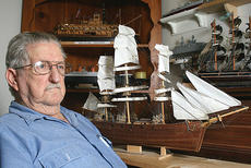 """<div class=""""source"""">Stephen Lega</div><div class=""""image-desc"""">Bela Smith has been building model ships for decades. He is pictured with his model of the USS Constitution.</div><div class=""""buy-pic""""><a href=""""/photo_select/1346"""">Buy this photo</a></div>"""