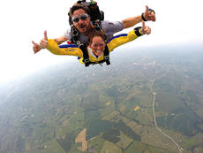 "<div class=""source"">Troy Woods</div><div class=""image-desc"">Sharon ""Sam"" Bach gives her sky diving experience two thumbs up. Pictured with Bach is parachuter Shawn Bernett. </div><div class=""buy-pic""><a href=""/photo_select/36579"">Buy this photo</a></div>"