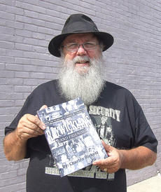 """<div class=""""source"""">Stephen Lega</div><div class=""""image-desc"""">Charlie Bickett will be signing copies of his book, """"Over 100 Years of Stories & tales of Raywickians"""" at 5:30 p.m. Thursday at the Marion County Public Library.</div><div class=""""buy-pic""""><a href=""""http://web2.lcni5.com/cgi-bin/c2newbuyphoto.cgi?pub=015&orig=08-27-14_bickett_book_signing_pic.jpg"""" target=""""_new"""">Buy this photo</a></div>"""