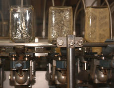 """<div class=""""source"""">Stephen Lega</div><div class=""""image-desc"""">Bottles are rinsed with Maker's Mark before they are filled. </div><div class=""""buy-pic""""><a href=""""http://web2.lcni5.com/cgi-bin/c2newbuyphoto.cgi?pub=015&orig=08-27-14_bottling_line_pic_6.jpg"""" target=""""_new"""">Buy this photo</a></div>"""
