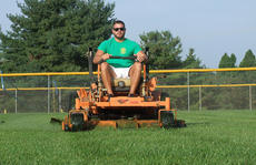"<div class=""source"">Stephen Lega</div><div class=""image-desc"">Patrick ""Cletus"" Spalding mows the outfield at Gorley Field Friday to prepare for a weekend softball tournament. </div><div class=""buy-pic""><a href=""/photo_select/36676"">Buy this photo</a></div>"