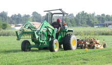 "<div class=""source"">Stephen Lega</div><div class=""image-desc"">Joseph Lewis drives a John Deere tractor pulling a ""batwing"" to mow the grass at the disc golf course on Fairground Road. </div><div class=""buy-pic""><a href=""/photo_select/36678"">Buy this photo</a></div>"