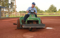 "<div class=""source"">Stephen Lega</div><div class=""image-desc"">Jerry Stumph drives a John Deere bunker rake to prepare the Gorley Field infield for a softball tournament. </div><div class=""buy-pic""><a href=""/photo_select/36674"">Buy this photo</a></div>"