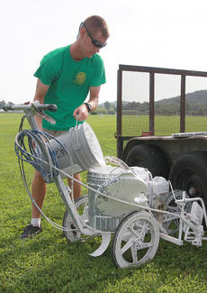 "<div class=""source"">Stephen Lega</div><div class=""image-desc"">Ryan Peterson pours paint into the machine used to mark the lines on the youth soccer fields.</div><div class=""buy-pic""><a href=""/photo_select/36681"">Buy this photo</a></div>"