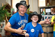 """<div class=""""source"""">Photo by Bramel Professional Photography</div><div class=""""image-desc"""">Ernie Brown Jr. """"The Turtleman"""" and Make-A-Wish recipient Austin Myers pose for a photo together. </div><div class=""""buy-pic""""></div>"""