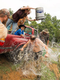 """<div class=""""source"""">Photo by Bramel Professional Photography</div><div class=""""image-desc"""">Make-A-Wish recipient Austin Myers, of Osh Kosh, Wisconsin, gets a front row seat for the filming of Turtleman's ALS Ice Bucket Challenge. </div><div class=""""buy-pic""""></div>"""