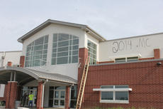 "<div class=""source"">Photo by Brandon Mattingly</div><div class=""image-desc"">The new Washington County High School facility was vandalized Friday morning, Aug. 22. Four individuals used spray paint to draw graffiti outside and inside the school building. The graffiti included several instances where the letters ""MC"" were displayed, apparently in an effort to pass blame to Washington County High School's athletic rivals in Marion County.</div><div class=""buy-pic""></div>"