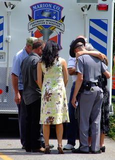 "<div class=""source"">Stephen Lega</div><div class=""image-desc"">Friends and Kentucky State Troopers try to comfort the woman who was riding in the truck.</div><div class=""buy-pic""></div>"