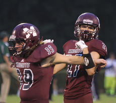 """<div class=""""source"""">Nick Schrager</div><div class=""""image-desc"""">Senior defensive back Tyler Fields helps senior linebacker Tommy Thomas stretch before the Saturday's game against Green County. </div><div class=""""buy-pic""""><a href=""""http://web2.lcni5.com/cgi-bin/c2newbuyphoto.cgi?pub=015&orig=09-03_football_pic_2.jpg"""" target=""""_new"""">Buy this photo</a></div>"""