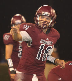 """<div class=""""source"""">Nick Schrager</div><div class=""""image-desc"""">Senior quarterback Hayden Taylor signals to another Knights player before a play Saturday against Green County.</div><div class=""""buy-pic""""><a href=""""http://web2.lcni5.com/cgi-bin/c2newbuyphoto.cgi?pub=015&orig=09-03_football_pic_4.jpg"""" target=""""_new"""">Buy this photo</a></div>"""
