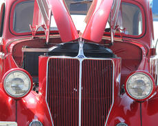 "<div class=""source"">Nick Schrager</div><div class=""image-desc"">Shown is the symmetrical symmetry of Barkley Courtwright?s 1934 Ford. </div><div class=""buy-pic""><a href=""http://web2.lcni5.com/cgi-bin/c2newbuyphoto.cgi?pub=015&orig=09-11-13_kroger_car_show_1.jpg"" target=""_new"">Buy this photo</a></div>"