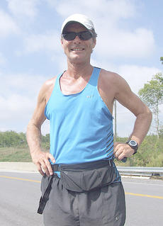 "<div class=""source"">Stephen Lega</div><div class=""image-desc"">Tom Denniss of Sydney, Australia, passed through Marion County last week as part of his attempt to run around the world.</div><div class=""buy-pic""><a href=""http://web2.lcni5.com/cgi-bin/c2newbuyphoto.cgi?pub=015&orig=09-12-12%2Btom%2527s%2Bnext%2Bstep-vertical%2BB%2Bpic.jpg"" target=""_new"">Buy this photo</a></div>"