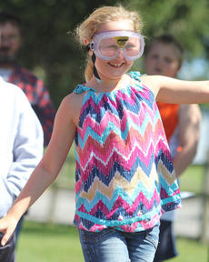 """<div class=""""source"""">Nick Schrager</div><div class=""""image-desc"""">Madison Wise gives a grin as she tries walking in a straight line while wearing impairment goggles.  </div><div class=""""buy-pic""""><a href=""""/photo_select/29811"""">Buy this photo</a></div>"""