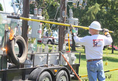 """<div class=""""source"""">Nick Schrager</div><div class=""""image-desc"""">Clarence Greene with the Kentucky Association of Electric Cooperatives demonstrates the shocking power of electricity. </div><div class=""""buy-pic""""><a href=""""/photo_select/29813"""">Buy this photo</a></div>"""