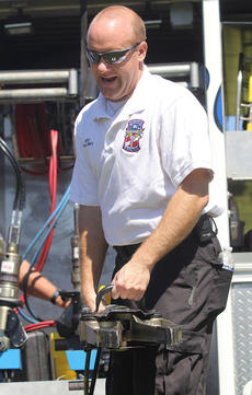 """<div class=""""source"""">Nick Schrager</div><div class=""""image-desc"""">Brian Smith with the Marion County Rescue Squard demonstrates how emergency personnel use the jaws of life.  </div><div class=""""buy-pic""""><a href=""""/photo_select/29815"""">Buy this photo</a></div>"""