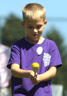 """<div class=""""source"""">Nick Schrager</div><div class=""""image-desc"""">Kaden Raley tries his hand at balancing an egg while walking.  </div><div class=""""buy-pic""""><a href=""""/photo_select/29817"""">Buy this photo</a></div>"""