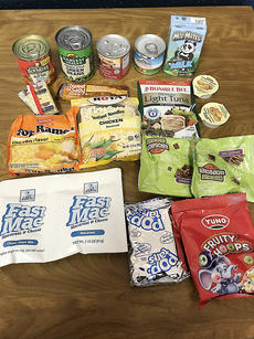 "<div class=""source""></div><div class=""image-desc"">This is a typical selection of food items provided through the BackPack program. </div><div class=""buy-pic""></div>"