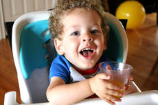 """<div class=""""source"""">Stevie Lowery</div><div class=""""image-desc"""">Eli Bright finishes off his orange juice after gobbling up two Toaster Strudels for breakfast Thursday morning. Many children with SMA have feeding tubes, and are never physically able to eat real food because of their inability to swallow properly. </div><div class=""""buy-pic""""><a href=""""/photo_select/57840"""">Buy this photo</a></div>"""