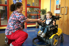 """<div class=""""source"""">Stevie Lowery</div><div class=""""image-desc"""">Eli Bright, 3, gives Kristy Newton, the school nurse at Glasscock Elementary, a high five on his first day of preschool Monday. </div><div class=""""buy-pic""""><a href=""""/photo_select/57839"""">Buy this photo</a></div>"""