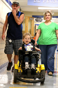 """<div class=""""source"""">Stevie Lowery</div><div class=""""image-desc"""">Eli Bright, 3, leads the way to his preschool classroom Monday morning at A.C. Glasscock Elementary School. Following closely behind him are his parents, Jesse Bright and Natalie Wheatley. </div><div class=""""buy-pic""""><a href=""""/photo_select/57838"""">Buy this photo</a></div>"""