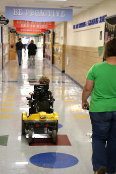 """<div class=""""source"""">Stevie Lowery</div><div class=""""image-desc"""">Eli Bright, 3, leads the way to his preschool classroom Monday morning at A.C. Glasscock Elementary School. </div><div class=""""buy-pic""""><a href=""""/photo_select/57850"""">Buy this photo</a></div>"""