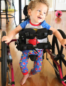 """<div class=""""source"""">Stevie Lowery</div><div class=""""image-desc"""">Eli can walk from one end of his house to the other with the help of a walker, and he recently started lifting his left leg straight up in the air without any assistance.  </div><div class=""""buy-pic""""><a href=""""/photo_select/57841"""">Buy this photo</a></div>"""