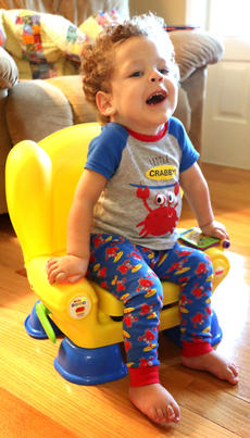 """<div class=""""source"""">Stevie Lowery</div><div class=""""image-desc"""">Eli sits on his special """"throne."""" Sitting up on his own, which used to be a challenge, is a piece of cake now. </div><div class=""""buy-pic""""><a href=""""/photo_select/57842"""">Buy this photo</a></div>"""