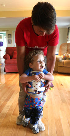 """<div class=""""source"""">Stevie Lowery</div><div class=""""image-desc"""">Eli gets some exercise and walks with assistance from Cindy Robinson, a physical therapist with First Steps, who has been working with him since he was six months old. Thursday was his last day with Robinson.</div><div class=""""buy-pic""""><a href=""""/photo_select/57848"""">Buy this photo</a></div>"""