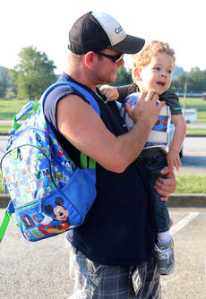 """<div class=""""source"""">Stevie Lowery</div><div class=""""image-desc"""">Eli Bright is excited to start his first day of preschool at A.C. Glasscock Elementary School Monday morning. Holding Eli is his father, Jesse Bright. </div><div class=""""buy-pic""""><a href=""""/photo_select/57849"""">Buy this photo</a></div>"""