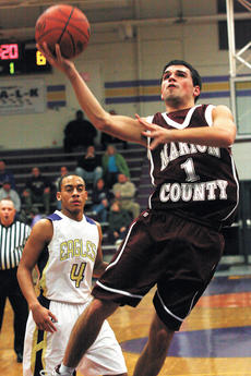 """<div class=""""source"""">Jessica Veatch</div><div class=""""image-desc"""">Senior Josh Brockman goes in for a layup in the victory against Campbellsville Friday night.</div><div class=""""buy-pic""""><a href=""""http://web2.lcni5.com/cgi-bin/c2newbuyphoto.cgi?pub=015&orig=1-19%2Bboys%2Bbeat%2Bcville%2Bpic%2B013.jpg"""" target=""""_new"""">Buy this photo</a></div>"""