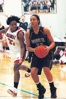 """<div class=""""source"""">Jessica Veatch</div><div class=""""image-desc"""">Sophomore Kyvin Goodin-Rogers comes to a jump stop as she prepares to shoot the ball in Saturday night's game against the No. 1 ranked DuPont Manual Lady Crimsons. </div><div class=""""buy-pic""""><a href=""""http://web2.lcni5.com/cgi-bin/c2newbuyphoto.cgi?pub=015&orig=1-26%2Blady%2Bknights%2Bvs%2Bmanual%2B035%2Bpic.jpg"""" target=""""_new"""">Buy this photo</a></div>"""