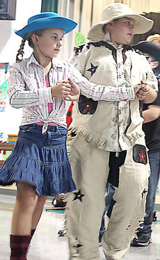 """<div class=""""source"""">Stevie Lowery</div><div class=""""image-desc"""">Lindsay Fark and Jonathan Thompson perform a square dance routine during a play at Calvary Elementary.</div><div class=""""buy-pic""""><a href=""""http://web2.lcni5.com/cgi-bin/c2newbuyphoto.cgi?pub=015&orig=10-05-11%2BCES%2Bplay%2B1%2Bcropped.jpg"""" target=""""_new"""">Buy this photo</a></div>"""
