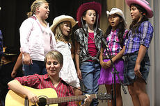 """<div class=""""source"""">Stevie Lowery</div><div class=""""image-desc"""">Music teacher Jessica Floyd plays the guitar and sings along with cowgirls (from left) Alexis Lyvers, Avery Stiles, Makayla Spalding, Mya Emmons and Santana Alvarez.</div><div class=""""buy-pic""""><a href=""""http://web2.lcni5.com/cgi-bin/c2newbuyphoto.cgi?pub=015&orig=10-05-11%2BCES%2Bplay%2B3.jpg"""" target=""""_new"""">Buy this photo</a></div>"""