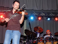 """<div class=""""source"""">Stephen Lega</div><div class=""""image-desc"""">Jeb Reinhiller plays the fiddle during 32 Below's set at the TG Kentucky 10th anniversary celebration concert Saturday evening. Luke Nygaard is on drums.</div><div class=""""buy-pic""""><a href=""""/photo_select/6890"""">Buy this photo</a></div>"""