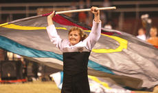 """<div class=""""source"""">Stephen Lega</div><div class=""""image-desc"""">Laura Ackermann picks up a flag after putting down her instrument temporarily. </div><div class=""""buy-pic""""><a href=""""/photo_select/30400"""">Buy this photo</a></div>"""