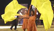 """<div class=""""source"""">Stephen Lega</div><div class=""""image-desc"""">Color guard members Jarie Newby (front) and Megan Newton are in sync.</div><div class=""""buy-pic""""><a href=""""/photo_select/30401"""">Buy this photo</a></div>"""