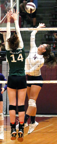 """<div class=""""source"""">Gerard Flanagan</div><div class=""""image-desc"""">Addison Gordon goes for the ball at the net as a Green County defenders rises up for a block in Marion County's two set loss to the Green County Lady Dragons on Sept. 26 at the Roby Dome.</div><div class=""""buy-pic""""><a href=""""/photo_select/58368"""">Buy this photo</a></div>"""