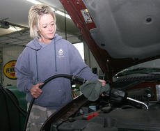 """<div class=""""source"""">Stephen Lega</div><div class=""""image-desc"""">Pam Hutchins has been changing oil at Clean as a Whistle for 19 years. </div><div class=""""buy-pic""""><a href=""""/photo_select/30519"""">Buy this photo</a></div>"""
