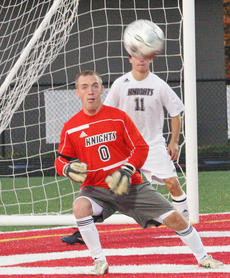 """<div class=""""source"""">Jessica Veatch</div><div class=""""image-desc"""">Senior Michael Costello concentrates on making a save in the regional tournament soccer game against Central Hardin on Oct. 16.</div><div class=""""buy-pic""""><a href=""""http://web2.lcni5.com/cgi-bin/c2newbuyphoto.cgi?pub=015&orig=10-24%2Bboys%2Bsoccer-172.jpg"""" target=""""_new"""">Buy this photo</a></div>"""