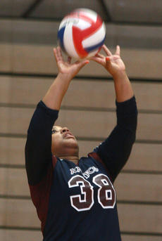 """<div class=""""source"""">Stephen Lega</div><div class=""""image-desc"""">Lady Knight junior setter Shaniqua Young sets the ball in a junior varsity match against Thomas Nelson. </div><div class=""""buy-pic""""><a href=""""/photo_select/29996"""">Buy this photo</a></div>"""