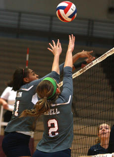 """<div class=""""source"""">Stephen Lega</div><div class=""""image-desc"""">Marion County senior middle hitter Alexus Calhoun and junior Sara Abell attempt to block a hit by Thomas Nelson. </div><div class=""""buy-pic""""><a href=""""/photo_select/29992"""">Buy this photo</a></div>"""