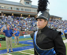 """<div class=""""source"""">Photo submitted</div><div class=""""image-desc"""">For the second consecutive year, Lindsey Wilson College student Leanna Begley of Lebanon, right, will be the field commander of the Blue Raider Marching Band, which is under the guidance of LWC Director of Instrumental Ensembles Tim Allen, left. Begley, a graduate of Marion County High School, says fans will see and hear the best edition yet of the Blue Raider Marching Band. """"I feel honored to be part of the first three Lindsey Wilson marching bands -- there's such a sense of pride of what we've become,"""" said Begley, an accounting major. """"It's such an honor to be field commander for the second year in a row."""" </div><div class=""""buy-pic""""></div>"""