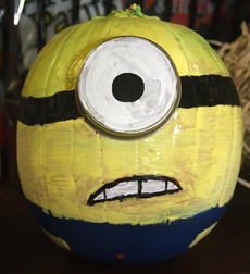 "<div class=""source"">Stevie Lowery</div><div class=""image-desc"">Pictured is a pumpkin decorated like one of the minions from ""Despicable Me."" </div><div class=""buy-pic""><a href=""/photo_select/30713"">Buy this photo</a></div>"