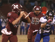 """<div class=""""source"""">Will Phillips</div><div class=""""image-desc"""">Junior quarterback Hayden Taylor scrambles and looks for a receiver downfield.</div><div class=""""buy-pic""""><a href=""""/photo_select/30612"""">Buy this photo</a></div>"""