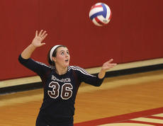 """<div class=""""source"""">Nick Schrager</div><div class=""""image-desc"""">Lady Knight senior left side hitter Abby Murphy serves the ball against Elizabethtown in the regional tournament.</div><div class=""""buy-pic""""><a href=""""http://web2.lcni5.com/cgi-bin/c2newbuyphoto.cgi?pub=015&orig=11-06_volleyball_pic_1.jpg"""" target=""""_new"""">Buy this photo</a></div>"""